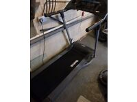 Reebock Edge 2.2 treadmill, excellent condition, hardly used. protective cover still intact.