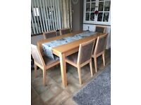 Dining table and 6 chairs in good condition.