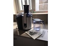 Philips Juicer, model HR1861 with jug and instruction booklet.