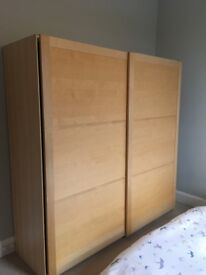 Large wardrobe/cupboard with sliding doors, built-in shelves and laundry basket