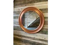 Stunning large copper coloured round contemporary mirror