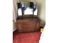 Waethered oak vintage dressing table with drawers and cupboards and good condition mirror