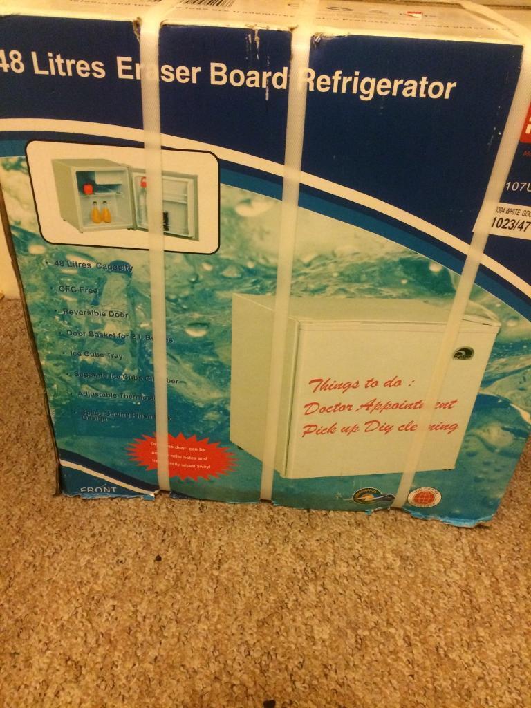 Brand new 48l mini fridge with white board