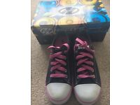 Heelys: Size 4, Black and Pink. Hardly used. In original box