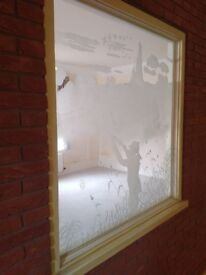 Beautiful etched glass window with a hunting scene