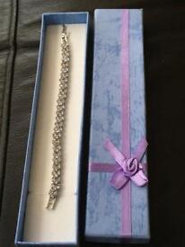 Ladies silver bracelet with white zirconia stones new
