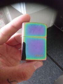 Official zipper lighter in spectrum colour.