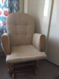 Gliding feeding chair with matching foot stool
