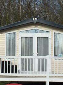 Luxury Caravan with full wrap around decking at 5* Haven Hopton Holiday Village.