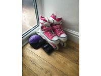 pink and white SFR roller blades with elbow and knee pads