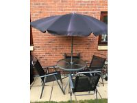 Garden table and chairs and umbrella