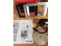 Philips digital photo frame with interchangeable frames, charger disc and instructions