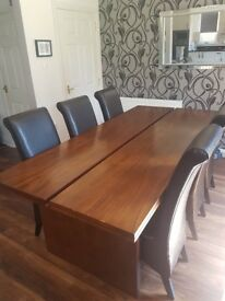 Lovely wood veneer table with 6 leather chairs.