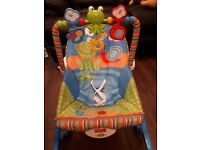 Vibrating baby chair with musical overhead frog. Good condition, baby outgrown.