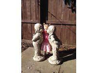2 kissing children garden statues