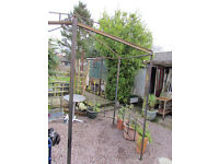 Metal framed gazebo in need of attention