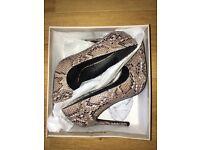 Ladies high heel shoes size 4 never worn
