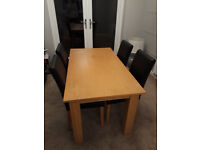 Oak-effect dining table
