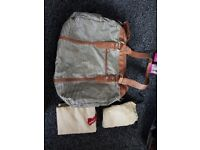 Babymel changing back with bottle bag and changing mat in very good condition