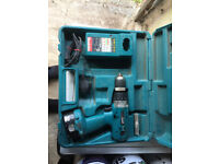 Makita portable power drill and charger for sale