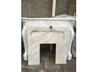 White fireplace and marble back