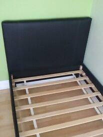 Argos Hygena Erica Single Bed. Black leather effect. Wooden slats.