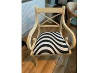 Wooden chair with zebra pattern seat cover