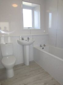 Unfurnished 2 bedroomed granite house with driveway to front providing off-road parking for 2 cars