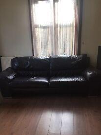 2 dark drown 3 seater sofas