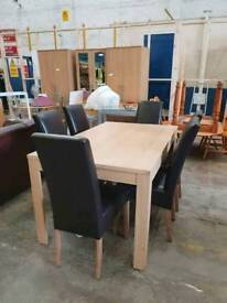 Extending light wood dining table with 6 chairs