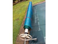 Swimming pool SOLAR cover & reel system 'Plastica' brand Roller/Rollaway. Pond cover fish