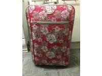 Beautiful pink suit case in very good condition