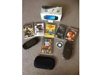 Sony PSP console immaculate condition and 7 games and carry cases