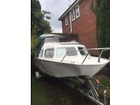 17foot fishing boat with cabin and trailer, 30hp mercury outboard engine, selling due to ill health.