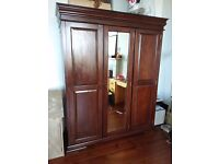 Large solid wood wardrobe; disassembled any ready for pickup; £100
