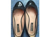Worn out black flats