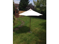 Garden Parasol and Cast Iron Base in good condition