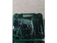 Bosch drill with complete set of drill bits