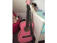 Pink guitar with stand and bag