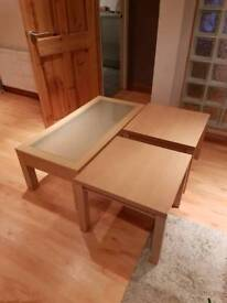 Glass coffee table and two tables.