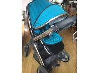 Baby style oyster travel system with Teal colour pack and black carry cot