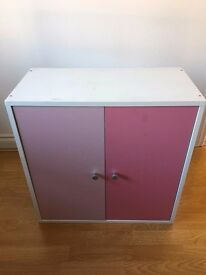 Cabinet with pink doors