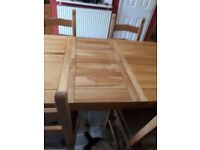 Solid oak dining table with 5 chairs