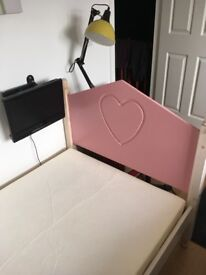 Child's single bed with mattress