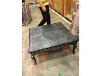 Black coffee table with silver ornate detail - £100.00