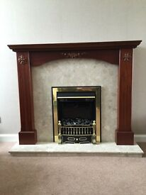 Fire surround with marble hearth and insert with electric fire.