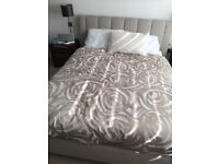king size beige fabric bed frame/mattress/side tables/lamps