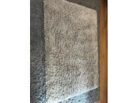 Medium sized cream rug