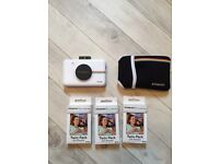 Polaroid camera with case and printer paper