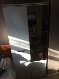 Wardrobe Double Front mirror 3 Drawers Good condition. Height 6 foot Width 2' 9'' Depth 1' 8''